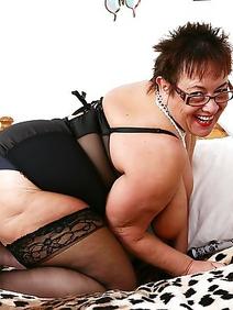 british women; busty; chubby; masturbation; solo; stockings;