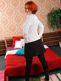 milf; pantyhose; redhead; shaved pussy; solo;