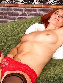 busty; masturbation; milf; redhead; shaved pussy; solo; stockings; toys;