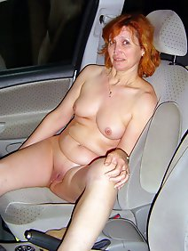 busty; car; chubby; outdoors; public;