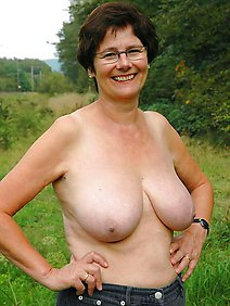 busty; chubby; flashing; outdoors; public;